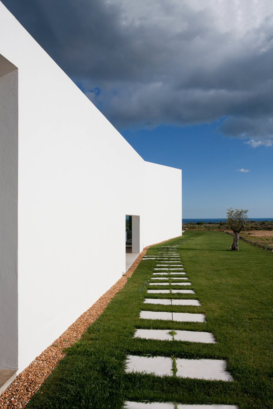 The shape of the home flares towards the front of the lot, expanding from private to public space. Make This Seaside Villa in Southern Portugal Your Own Private Resort For $2M - Photo 8 of 9