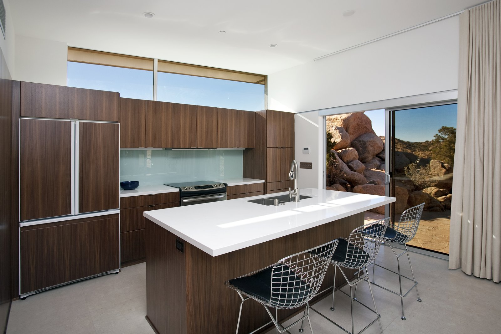 The kitchen boasts cabinets from a high-end Canadian vendor. Large cork tiles run throughout the home.  Photo 5 of 8 in Offered at $674K, This Hybrid Prefab Is in Tune With the Californian Desert