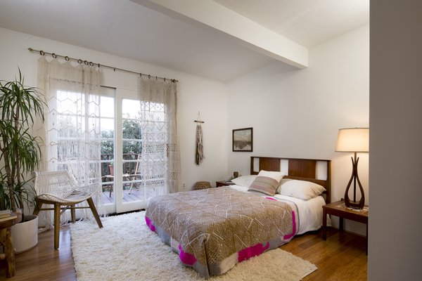 The third bedroom on the main floor opens out onto a private terrace and has an additional space for storage or laundry. The house boasts a bonus room on the lowest floor that can be reached from an exterior stairwell.