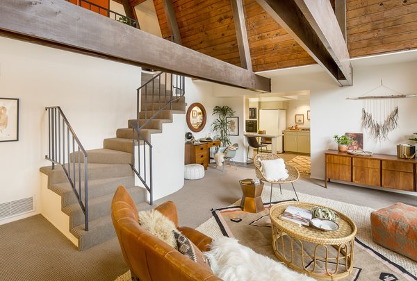 """Descending the staircase, you enter the open living area. Says the seller's son of the 1,701-square-foot space, """"It's humble in size, but grand in its impact."""""""