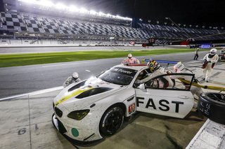 "John Baldessari Blazes a Trail at the Daytona International Speedway With BMW Art Car #19 - Photo 10 of 11 - ""You're asleep at 4:30 in the morning, and someone wakes you up in the motorhome and says you need to be in pit lane,"" says driver Alexander Sims. ""You rush up there, and there's a yellow, and you get in sooner than expected. Now you're doing 180 miles an hour when you were asleep 30 minutes before. So that's the strange and difficult part of an endurance race—getting your mind ready to jump in."""
