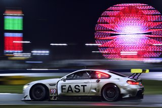 John Baldessari Blazes a Trail at the Daytona International Speedway With BMW Art Car #19 - Photo 9 of 11 - Night falls, the track is slick with rain, and the atmosphere of the infield grows more delirious as fans stay up to watch the race unfold.