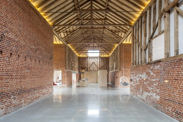 The renovation honors the grand, cathedral-like proportions of the original barn. In addition to the