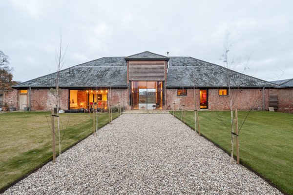 Modern home with outdoor, front yard, and grass. Photo  of Church Hill Barn