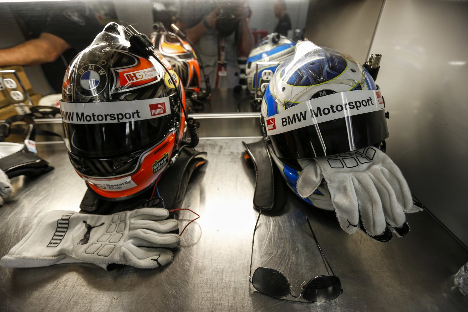 In the BMW motorhome, fans are directed at helmets to dry off the sweat.
