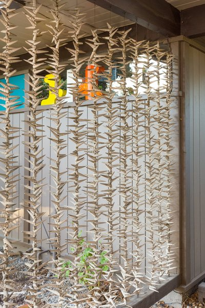 Strung seashells make up an organic screen for the carport, a natural touch added by the seller.