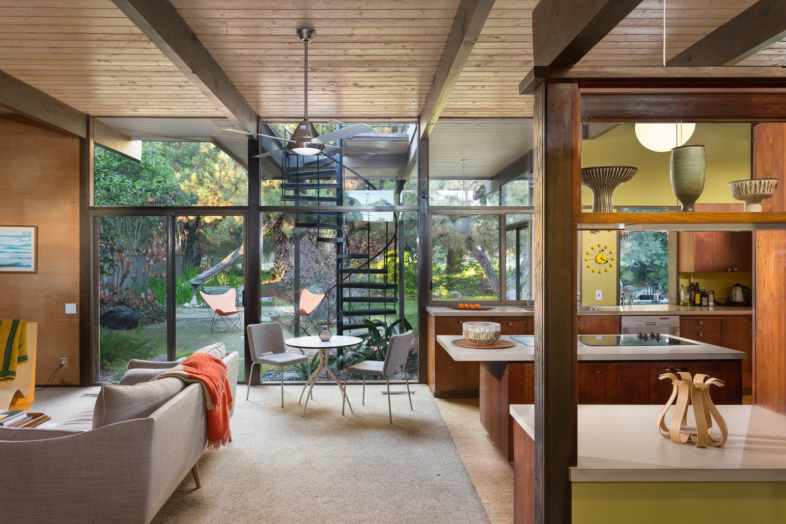 The kitchen and den, pictured above, as well as the living room and covered veranda open up to the backyard thanks to large glass walls. The rear of the house was rebuilt by architect Rufus Turner following a fire in the living room in 1964.  Photo 4 of 11 in Snag This Midcentury Stunner in Southern California For $799K