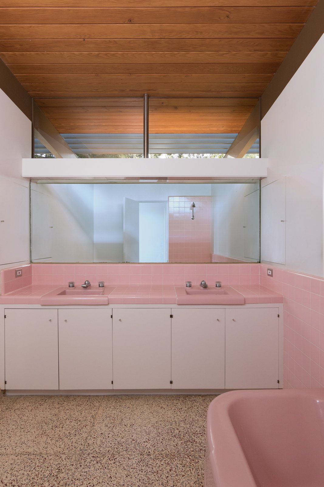 Tagged: Bath Room, Tile Counter, Drop In Sink, Freestanding Tub, Vinyl Floor, and Ceramic Tile Wall.  Photo 7 of 9 in Nearly Slated For Destruction, a Restored Neutra in West Covina Asks $1.8M