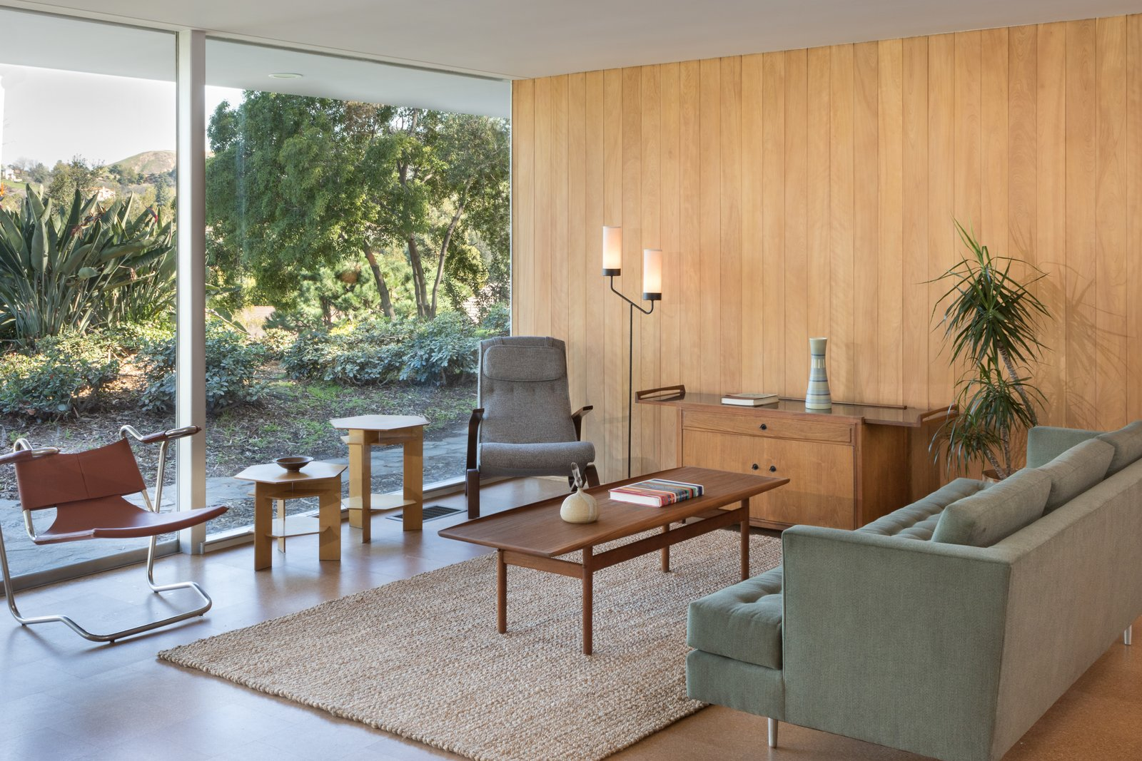 In the mid-fifties, modern residential architecture was suspect in the Eastern San Gabriel Valley. The Roberts family requested a ranch house, but Neutra steered his clients towards his vision. Mrs. Roberts wanted a low plaster ceiling throughout the home, which Neutra refused, choosing tongue-and-groove Douglas fir boards instead. He compromised with a plaster ceiling in the living room, pictured above. Tagged: Living Room, Sofa, and Medium Hardwood Floor.  Photo 3 of 9 in Nearly Slated For Destruction, a Restored Neutra in West Covina Asks $1.8M