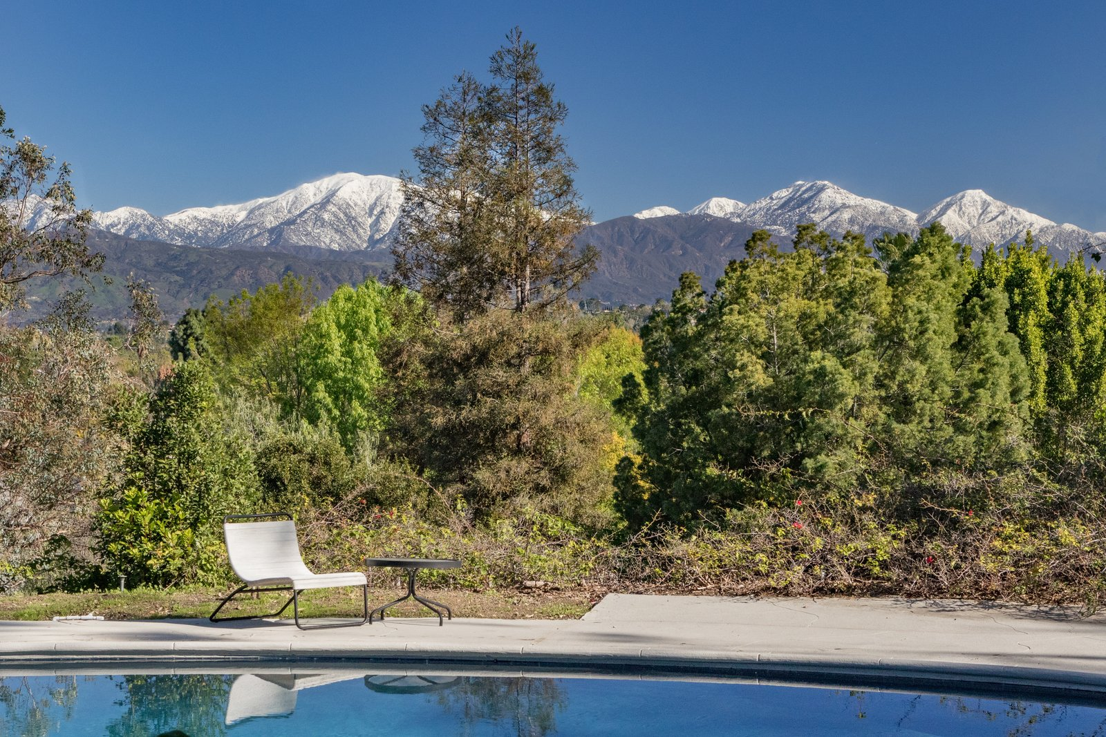 To the north is a view of Mt. Baldy and the San Gabriel Mountains, which become snow-capped peaks in the winter.  Photo 9 of 9 in Nearly Slated For Destruction, a Restored Neutra in West Covina Asks $1.8M
