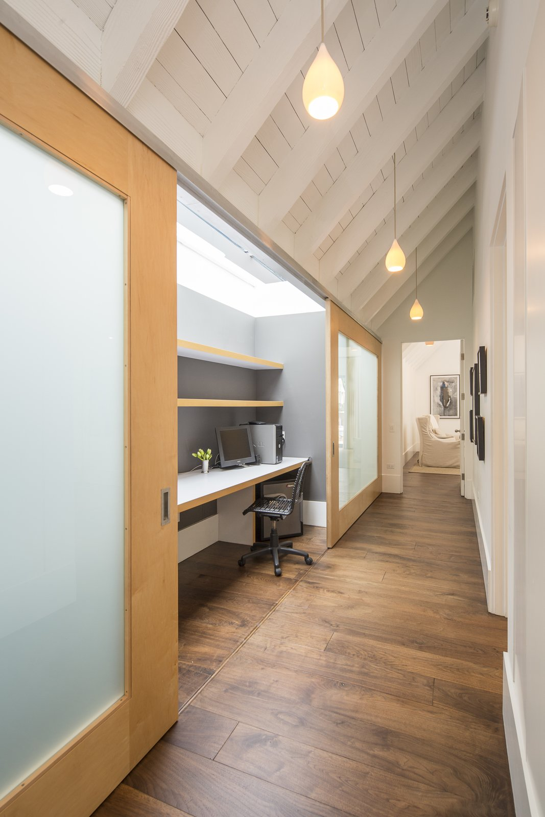 Skylights illuminate this tucked-away desk, which the homeowner can hide by sliding the doors closed.  Photo 6 of 10 in For the Entertainer, This $5.5M Home in Southern California Fits the Bill