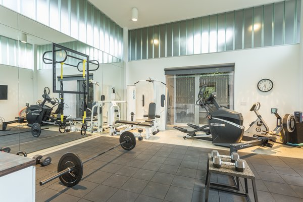 Currently, the pool house is set up as a home gym.