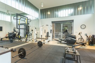 For the Entertainer, This $5.5M Home in Southern California Fits the Bill - Photo 9 of 9 - Currently, the pool house is set up as a home gym.