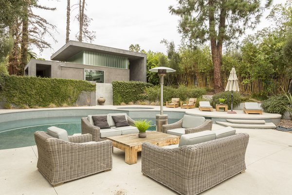 A pool and hot tub divide the main house from the pool house, which has two showers, storage space, and utilities—making it an ideal guesthouse or in-law unit.