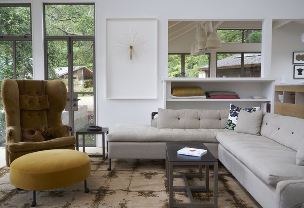 The living room features furniture from BDDW. Much of art arrayed throughout the home was collected through auctions; Southern Exposure and The Luggage Gallery are two favorite sources.