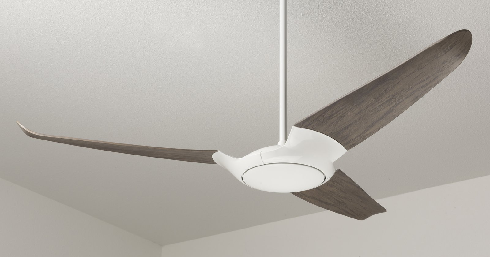 Here, the fan is shown in a three-blade configuration with a dark wood finish. Says Indio da Costa,  Photo 7 of 8 in Taking Flight: A Dose of Brazilian Design Lifts the Ceiling Fan to New Heights