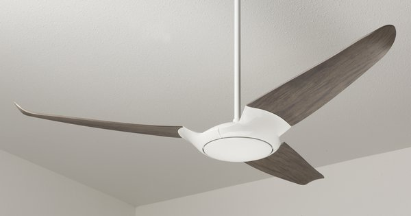 "Here, the fan is shown in a three-blade configuration with a dark wood finish. Says Indio da Costa, ""Every aspect of your home reflects your personality and taste. A ceiling fan should be more carefully chosen than any other furniture or piece, for once it's installed it becomes the central focus point of a room."""