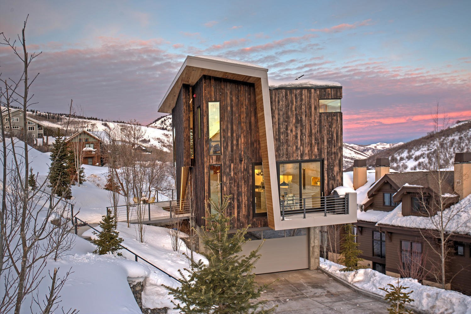 Tagged: Exterior, Cabin Building Type, and Wood Siding Material.  Photo 1 of 10 in A Plunging Roof Carves Out Space in This Park City Home Offered at $2.4M