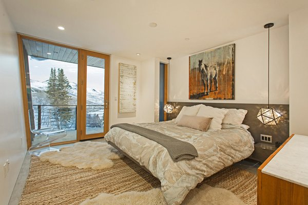 The master bedroom has access to a private terrace with alpine vistas.