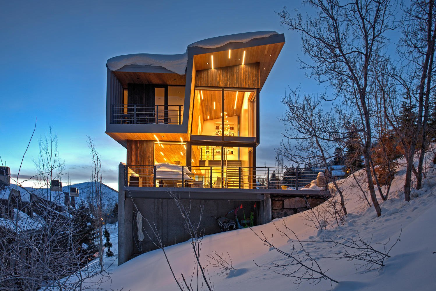 The shou sugi ban exterior siding stands as a bold contrast in the snow, and is