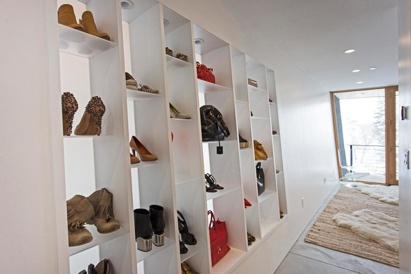 The multipurpose, built-in shelves in the master bedroom can hold shoes, accessories, books, or decor.