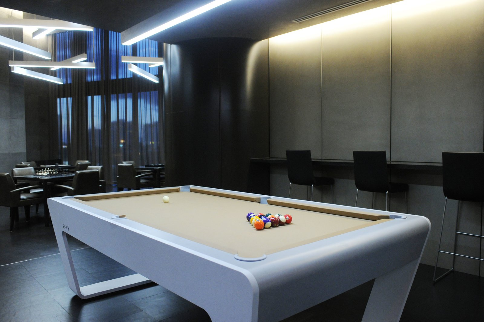 Multipurpose clubrooms offer residents and guests entertainment options outside of their units. A movie theatre plays new releases, while a game room is equipped with racing and golf simulators.  Photo 4 of 11 in Porsche Design's Lavish Residential Tower in Miami Lifts Residents and Cars Sky High