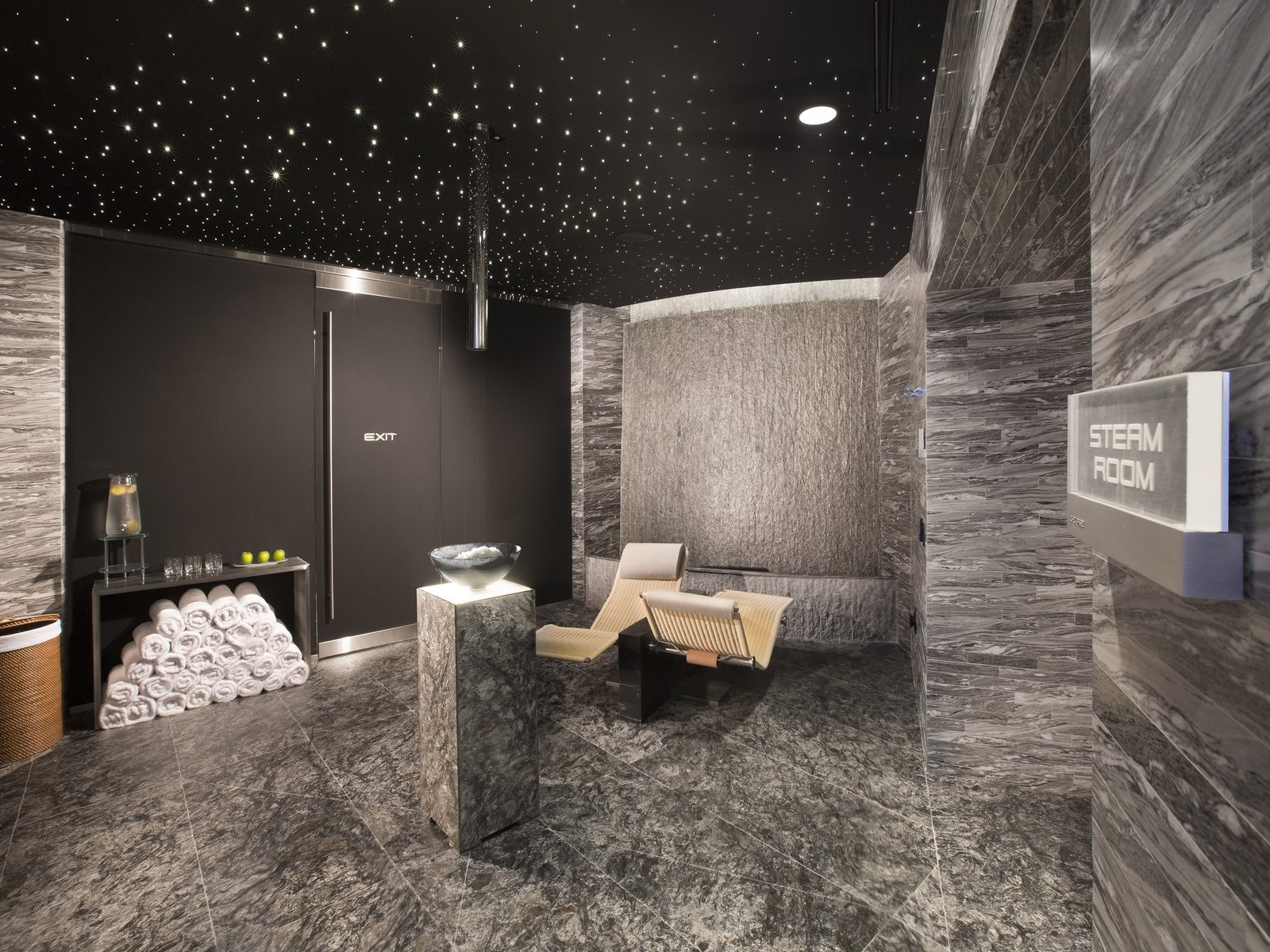 The state-of-the-art spa includes a steam room and sauna, treatment rooms, and Vichy showers. A fitness center, yoga room, and salon are also in the building.