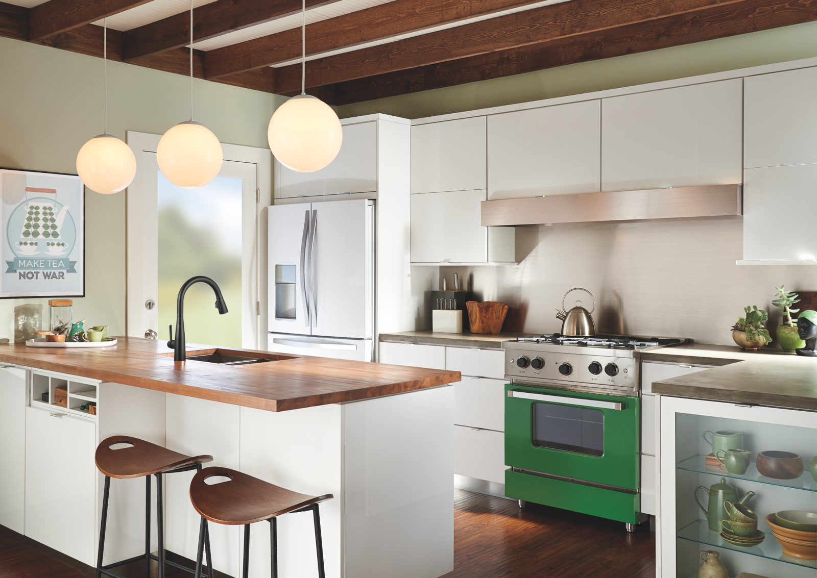 Tagged: Kitchen, Range, Range Hood, White Cabinet, Medium Hardwood Floor, Wood Counter, and Refrigerator.  Best Photos from 8 Ways to Refresh and Personalize Your Kitchen