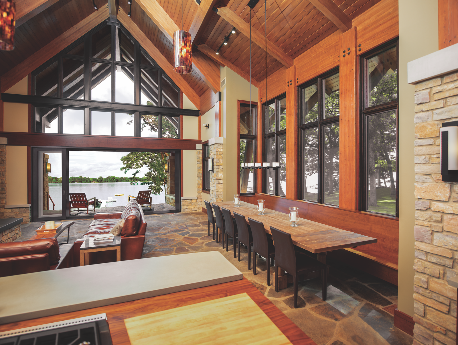This home merges an open living space with a serene porch overlooking the water with a Marvin Ultimate Multi-Slide Door.