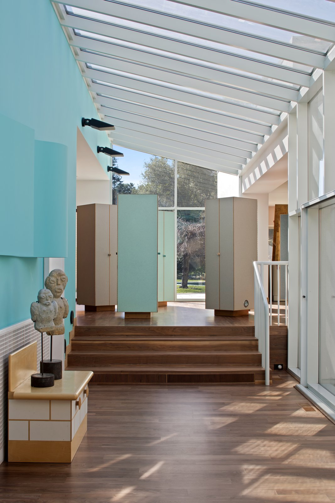 A glass atrium holds together four of the six pavilions that make up the home. Sottsass considered hallways to be unimaginative, preferring to create a flexible village of connected spaces.