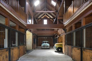 After Kelley's wife moved the horses to another property, he used one of the outbuildings as a design studio, and repurposed the barn for his classic car collection.