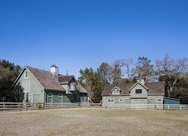 The lot originally housed the equestrian facilities of a larger, 10-acre estate. The stables, tack room, birthing shed, barn, and riding ring and turnouts still stand. Photo 11 of The Kelley Residence modern home