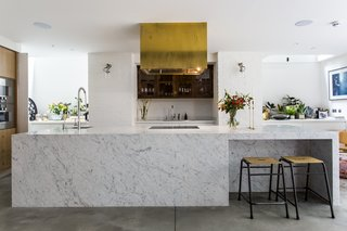 Stay in a Converted Victorian Cooperage in London - Photo 5 of 7 - Brass finishings and an eye-catching range hood contrast with cool Carrara marble.