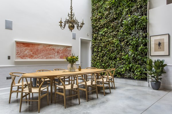 The living wall designed by Scotscape provides a refreshing backdrop to the dining area. Photo 7 of Clerkenwell Cooperage modern home