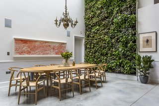 Stay in a Converted Victorian Cooperage in London - Photo 6 of 7 - The living wall designed by Scotscape provides a refreshing backdrop to the dining area.