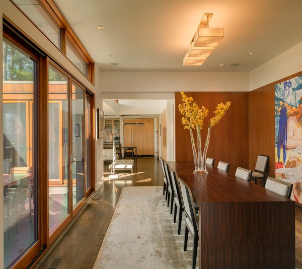 The formal dining room can open onto the terrace as well, while sliding pocket doors give the option of privacy and intimacy. Photo 6 of The Brown Residence modern home