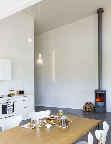 A C500 wood-burning stove from Contura creates a cozy atmosphere.