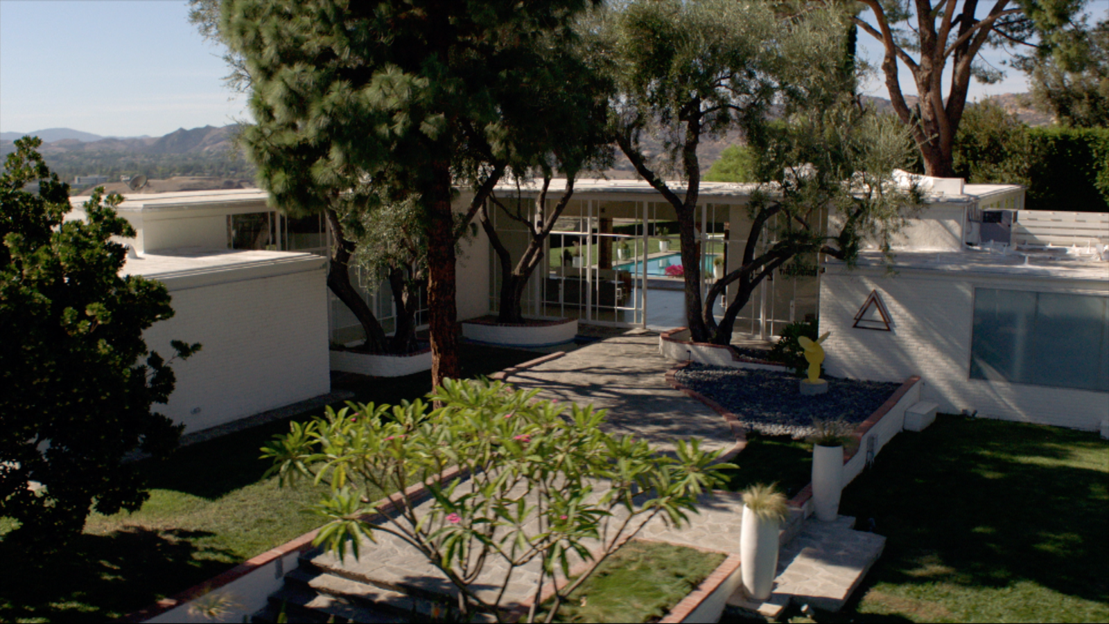 For the headquarters of the Institute of the Higher Mind—the organization that holds Kyle West in its grip—the crew filmed at the Fox Residence in Chatsworth, the stunning midcentury home where Frank Sinatra used to live.  Photo 10 of 10 in Here's How Hollywood Builds a Malibu Dream Home—on a Vancouver Soundstage