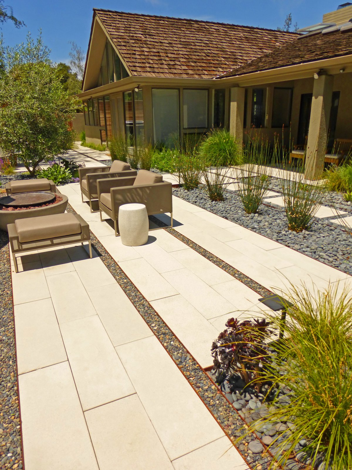 A private residence in Stanford, California, enjoys a varied patio landscape. Drawing the Line: Concrete Pavers That Advance Architectural Design - Photo 3 of 8