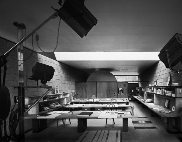An archival photo shows the interior of the detached studio with drafting tables awash in light through the enormous skylight above. Photo 9 of The Booth House modern home