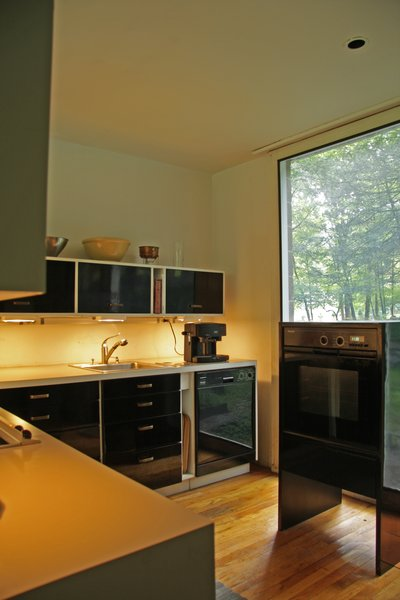 The original kitchen was designed by the Booths, and Robert renovated it in 2000, making it ergonomic for his wife Sirkka's shorter frame. Photo 6 of The Booth House modern home