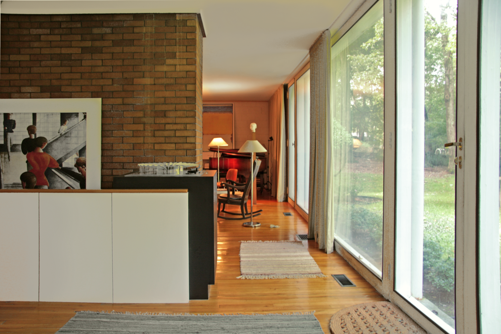 The entryway leads into the living room, and a low wall hides the staircase that leads to the lower level from view.  Photo 3 of 10 in With $1 Million, You Can Save Philip Johnson's First Commissioned House