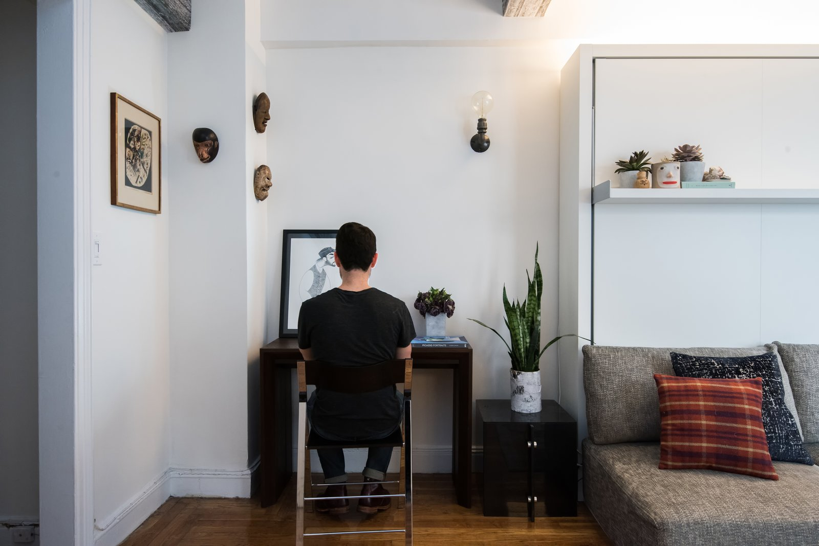 The Goliath does double duty as a console table and a dining table when fully extended.  Photo 6 of 6 in Big on Broadway, Small on Space: Inside the Studio of Actor Adam Kantor