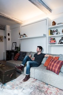 Big on Broadway, Small on Space: Inside the Studio of Actor Adam Kantor - Photo 2 of 5 - Strip lights above the Swing unit add height to the studio. ConcreteWall wall covering from Resource Furniture adorns the ceiling beams, an idea from designer Mike Harrison, who incidentally outfits many Broadway stars' dressing rooms.