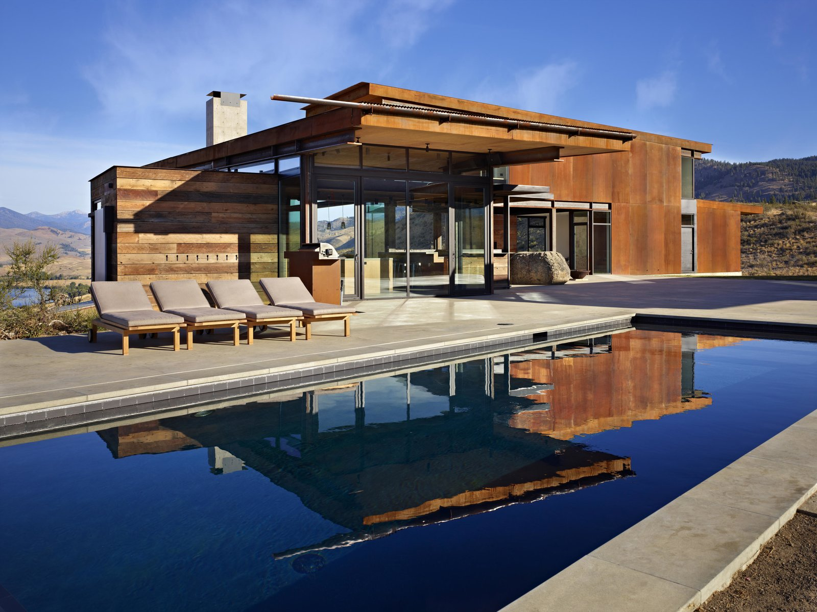 In the summer months, the pool provides a welcome respite from the heat. Tagged: Outdoor, Large Patio, Porch, Deck, Large Pool, Concrete Patio, Porch, Deck, Concrete Pool, and Desert. A Steel-and-Glass Compound Is One Family's Launchpad For Adventure - Photo 7 of 11
