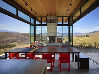 A Steel-and-Glass Compound Is One Family's Launchpad For Adventure - Photo 2 of 10 - The living room features glass walls that open up to the scenery, eliminating the barrier between interior and exterior.