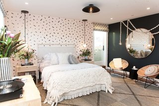 "Peek Inside the 2017 San Francisco Decorator Showcase - Photo 15 of 17 - Kristen Peña's goal for the teen bedroom was to create a ""cozy, livable haven for a 13-year-old girl that would embrace her during her transformation from girl to woman."" The blush pink and black hues represent this dichotomy, while textural elements like a handwoven Peg Woodworking headboard and rope lights by local artist Windy Chien add warmth. ""We feel that texture is very important in creating both that cozy feel and a level of sophistication in the room,"" says the designer."