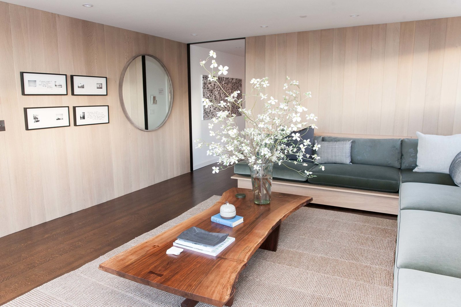 The penthouse living room and bar by Catherine Kwong features a Nakashima Cocktail Table. Kwong flew to Pennsylvania to meet with George Nakashima's daughter, Mira, and selected the slab of walnut that would anchor the room. Peek Inside the 2017 San Francisco Decorator Showcase - Photo 16 of 17