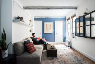 """Big on Broadway, Small on Space: Inside the Studio of Actor Adam Kantor - Photo 1 of 5 - """"My Resource Furniture system lets me hide the cumbersome qualities in an apartment,"""" says Kantor. """"It's a lot more elegant and opens up the space."""" Inspired to devise his own creative solutions, Kantor disguises his television with a mirror, creating the illusion of a larger room."""