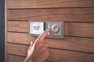 Turn Your Bathroom Into a Private Sanctuary With These Upgrades - Photo 5 of 5 - Large, intuitive-to-use buttons save your presets on the U by Moen controller, which is designed to blend into a variety of bathroom styles.